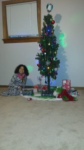 "Ilana with our ""Charlie Brown Christmas Tree"""